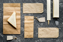 Take away with sandwich and paper bags on table background top view mock-up Royalty Free Stock Photo