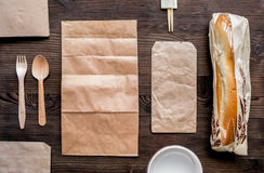 Take away with sandwich and paper bags table background top view mock-up Royalty Free Stock Photography