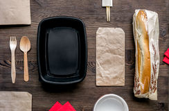 Take away with sandwich and paper bags table background top view mockup Stock Images