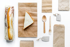 Take away set with paper bags on restourant background top view mockup Royalty Free Stock Photography