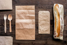 Take away set with paper bags restourant table background top view mockup Stock Photos