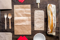 Take away set with paper bags on restourant table background top view mockup Stock Photo