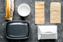Take away set with paper bags on restourant table background top view Stock Photos