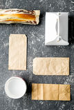 Take away set with paper bags on restourant table background top view Stock Photo