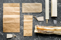 Take away set with paper bags on restourant table background top view Stock Image