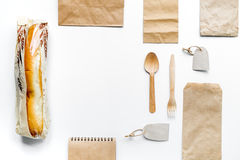 Take away set with paper bags on restourant table background top view Royalty Free Stock Photos