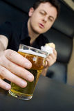 Take-a-beer. This guy deserves a fresh beer...CHEERS Royalty Free Stock Photography