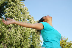 Take a big breath. Happy and healthy young woman relaxing with open arms Royalty Free Stock Photo