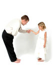 Take A Bow. Dad takes a bow to his little girl. Teaching good manners Royalty Free Stock Photography
