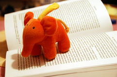 Take a break. Closeup of open book with nice perspective and toy implying a break Royalty Free Stock Photography
