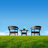 Take a break. Two chair and table on the grass field vector illustration