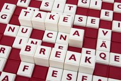 Take a break. A word game spelling out the words take a break among many letters Royalty Free Stock Images