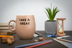 Take a break. Business and a success background. Coffee mug on a wooden table royalty free stock photography