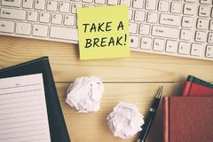 Take a break text on yellow paper. On top of computer keyboard stock image