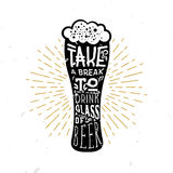 Take a break to drink a glass of beer - lettering inside the glass of beer. Take a break to drink a glass of beer! - lettering quote inside the glass of beer Stock Images