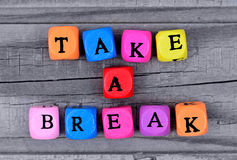 Take a break words on table. Take a break words on wooden table royalty free stock images