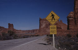 Take care. Main road with traffic sign in Arches-NP, Utah, USA Stock Images