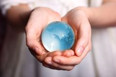 Take care about earth. Woman take care about globe glass earth Royalty Free Stock Photography
