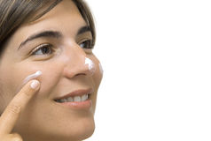 Take care the skin. Woman applying cream in the face Royalty Free Stock Photos