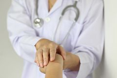 Take care and trust concept, Doctor holding hands of patient at hospital stock photos