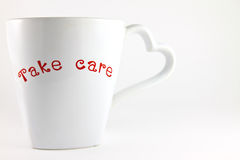 Take care word on a lover cup of coffee Royalty Free Stock Photos