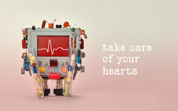 Take care of your hearts quote. Medic cardiogram monitor heartbeat line on red display cardiograph. Robot character with royalty free stock photo