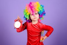 Take care of your time. Girl cute playful kid wear curly rainbow wig. Life is fun. Happy childhood. Happy little girl. International childrens day. Child care royalty free stock photo