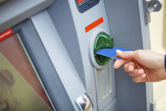 Take cash from the ATM Royalty Free Stock Photo
