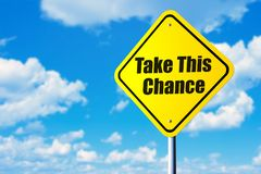Take this chance. Road sign and blue sky stock photo