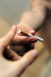 Take a cigarette Stock Photos