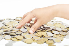 Take coins from the pile Royalty Free Stock Photos