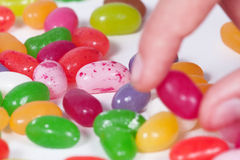Take a colored bean candy Stock Images