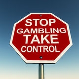 Take control. Stop gambling take control over a red roadsign warning over a clear blue sky vector illustration