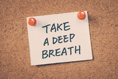 Take a deep breath. Note pin on bulletin board Royalty Free Stock Photos