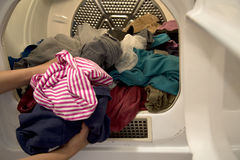 Take dried clothes out stock image