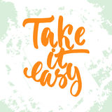 Take it easy - hand drawn lettering phrase on the white and green grunge background. Fun brush ink inscription royalty free illustration