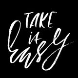 Take it easy. Hand drawn lettering. Vector typography design. Handwritten inscription. Take it easy. Hand drawn lettering. Vector typography design. Handwritten Stock Images