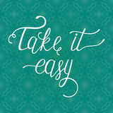 Take it easy. Hand drawn quote for your design on blue background with lace. Can be used for print bags, posters, cards, stationery and for web banners Royalty Free Stock Image