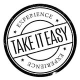 Take It Easy stamp. Grunge design with dust scratches. Effects can be easily removed for a clean, crisp look. Color is easily changed Royalty Free Stock Images