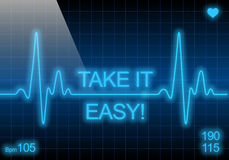 Take it easy - written on blue heart rate monitor. Expressing warning on heart condition Royalty Free Stock Images