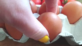Take an egg by hand. Slow motion stock footage