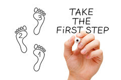 Take The First Step Footprint Concept. Hand drawing Taking The First Step concept with marker on transparent glass board Royalty Free Stock Photo
