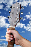 Take The Guitar With Clouds Stock Photo