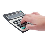Take a hand on the calculator Stock Images