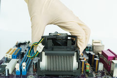 Take heat-sink by hand on board. Take heat-sink by hand on mainboard Stock Photography