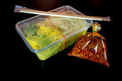 Take home food in plastic packaging. Spaghetti with sauce / Take home food in plastic packaging Stock Photo