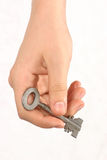 Take the key. Giving you key to your old home Stock Photo