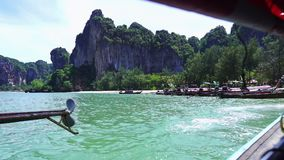 Take a long tail boat to Railay Beach stock video