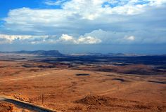 Take the long way home and walk it. Israeli negev road at winter weather Royalty Free Stock Photography