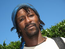 Take that look!. Black south african with blue bandanna on a sunny day Stock Photos